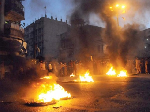 Protests broke out across the city including at Burns Road following the grenade attack. PHOTO: IRFAN ALI/EXPRESS