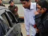 Relatives of slain Minorities Minister Shahbaz Bhatti inspect his bullet-riddled car following an attack in Islamabad on March 2, 2011. PHOTO: AFP