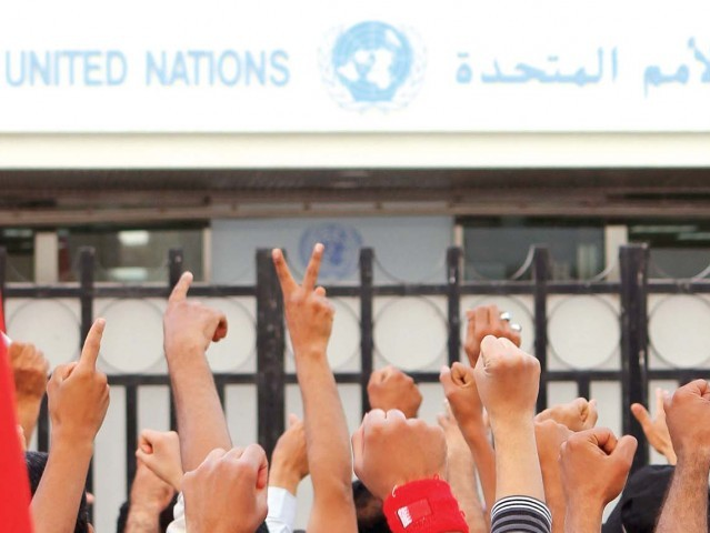 Bahrainis demonstrate in front of the UN headquarters in Manama as part of the anti-government protests since February 14. Pakistanis serving in Bahrain's security forces have reportedly been involved in a crackdown on protestors. PHOTO: AFP