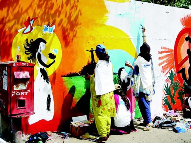 Students hard at work on a wall under the harsh March sun-PHOTO: EXPRESS/IJAZ MEHMOOD