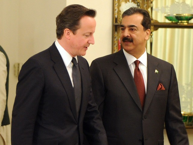 British Prime Minister David Cameron and his Pakistani counterpart Yousuf Raza Gilani chat prior to their meeting at the Prime Minister's House in Islamabad on April 5, 2011. PHOTO: AFP