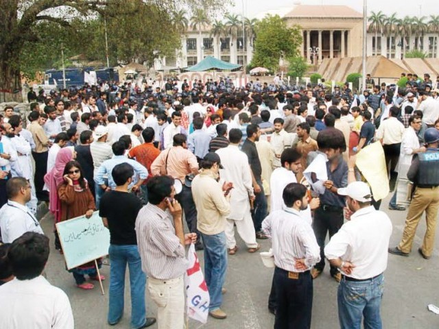 File photo of young doctors protesting in front of the Punjab Assembly. PHOTOS: EXPRESS/ABID NAWAZ