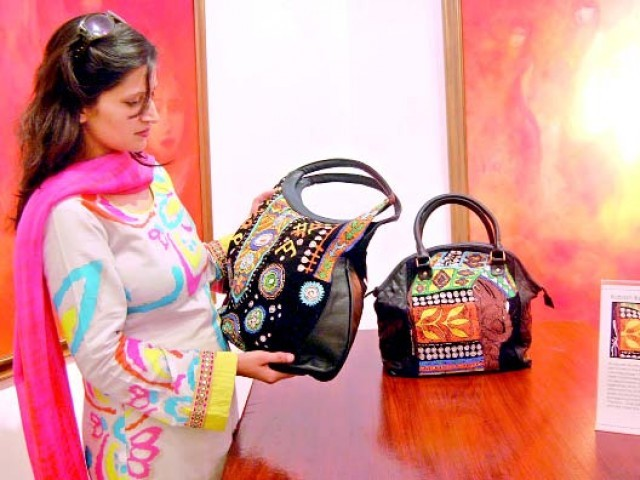 A visitor views handmade bags at Krizmah's exhibition held at Tanzara Gallery on Friday. PHOTO: MUHAMMAD JAVAID
