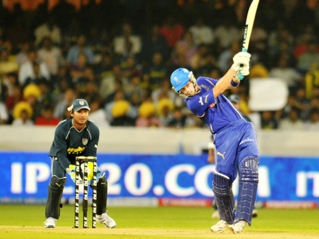 Rajasthan Royals player Johan Botha plays a shot as wicketkeeper of Deccan Chargers Kumar Sangakkara looks during the IPL Twenty20 match between Deccan Chargers and Rajasthan Royals at the Rajiv Gandhi International Stadium in Hyderabad on April 9, 2011. PHOTO: AFP