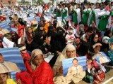 Large number of MQM supporters gathered in Gaddafi Stadium, Lahore for a rally. PHOTO: Athar Khan