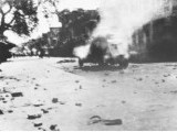 Archive photos showing troops advancing on the protesters (top), a sepoy takes aim early in the day (left), a military vehicle burns in