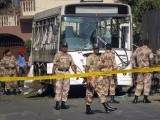Rangers arrive at the scene after a bus carrying Pakistan Navy officials was hit by a bomb in Karachi. PHOTO: REUTERS