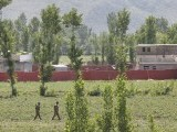 Pakistani soldiers walk past a compound, surrounded in red fabric, where locals reported a firefight took place overnight in Abbotabad, located in Pakistan's Khyber Pakhtunkhwa province May 2, 2011. Al Qaeda leader Osama bin Laden was killed in a firefight with U.S. forces in Pakistan on Sunday, ending a nearly 10-year worldwide hunt for the mastermind of the Sept. 11 attacks. Obama said U.S. forces led a targeted operation that killed bin Laden in Abbotabad north of Islamabad. PHOTO:REUTERS
