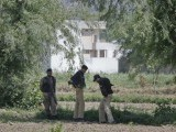 A Pakistani soldier and policemen stand near a compound, where locals reported a firefight took place overnight in Abbotabad, located in Pakistan's Khyber Pakhtunkhwa province May 2, 2011. Al Qaeda leader Osama bin Laden was killed in a firefight with U.S. forces in Pakistan on Sunday, ending a nearly 10-year worldwide hunt for the mastermind of the Sept. 11 attacks. Obama said U.S. forces led a targeted operation that killed bin Laden in Abbotabad north of Islamabad. PHOTO:REUTERS