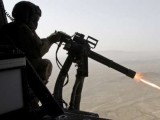 A file photo of a Nato-led coalition soldier firing during an operation against militants. PHOTO: REUTERS