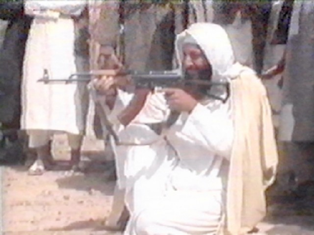 "This file photo taken on June 19, 2001 of a TV grab of former Saudi citizen Osama bin Laden, from a video tape said to have been prepared and released by bin Laden himself, during shooting training at al-Faruq base in Afghanistan. Al-Qaeda mastermind Osama bin Laden was killed late on May 1, 2011 in a firefight with covert US forces deep inside Pakistan, prompting President Barack Obama to declare ""justice has been done"" a decade after the September 11 attacks. PHOTO:AFP"
