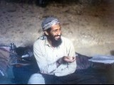 "This file photo taken in 1988 shows Osama bin Laden smiling as he sits in a cave in the Jalalabad region of Afghanistan. Al-Qaeda mastermind Osama bin Laden was killed late on May 1, 2011 in a firefight with covert US forces deep inside Pakistan, prompting President Barack Obama to declare ""justice has been done"" a decade after the September 11 attacks. PHOTO:AFP"