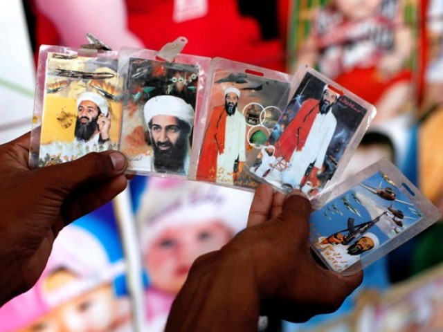 Images of al Qaeda leader Osama bin Laden are displayed for sale at road side road side poster shop in Saddar. PHOTO: ATHAR KHAN/EXPRESS
