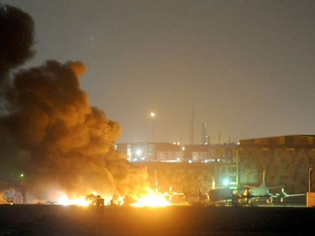 Flames and smokes belches out from a Pakistani military air base after an attack by militants in Karachi on May 22, 2011.  PHOTO: AFP