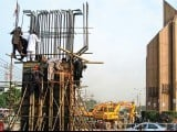 Construction work on the Kalma Chowk flyover continues. PHOTOS: EXPERSS/IJAZ MAHMOOD, FARHAN LASHARI