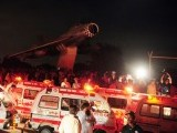 Ambulances gather outside the PAF base. PHOTO: AFP
