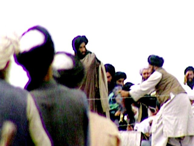 his file photo taken in 1996 of a TV screen grab taken secretly by BBC Newsnight shows Taliban's one-eyed spiritual leader Mullah Mohammed Omar (C) during a rally of his troops in Kandahar. PHOTO: AFP