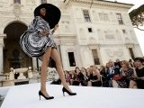 A model displays a creation by French fashion designer Pierre Cardin as he presented his new collection at the French academy in the gardens of Rome's Villa Medici, on June 23, 2011. PHOTO:AFP