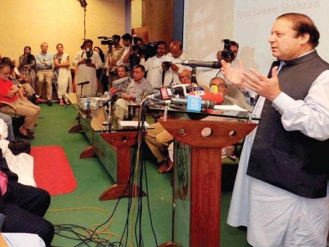 Nawaz Sharif addresses a memorial seminar honouring Saleem Shahzad. PHOTO: NNI