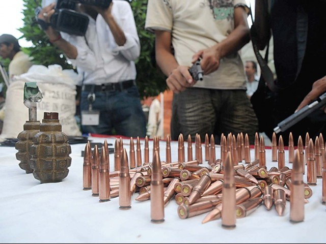 The suspects  were found with 20 kilogrammes of explosives, two hand grenades, two TT pistols, 20 feet of detonating wire and 200 bullets. PHOTO: IRFAN ALI/EXPRESS