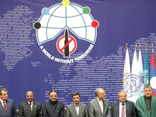"Tajik President Emomali Rahmon, Sudanese President Omar al-Beshir, Pakistani President Asif Ali Zardari, Iranian President Mahmoud Ahmadinejad, Iranian foreign minister Ali Akbar Salehi, Iraqi President Jalal Talabani and Afghan President Hamid Karzai pose for a picture during the ""International Conference on Global Fight Against Terrorism"" in Tehran. PHOTO: AFP"