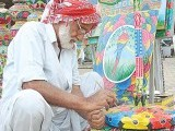 Artisans embellish their crafts with truck art, popular for it's characteristic animation and vibrant use of colours. PHOTOS: THE EXPRESS TRIBUNE