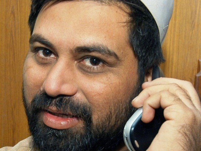 In this photo taken on November 28, 2006, Pakistani journalist Syed Saleem Shahzad talks on his cell phone. PHOTO: AFP