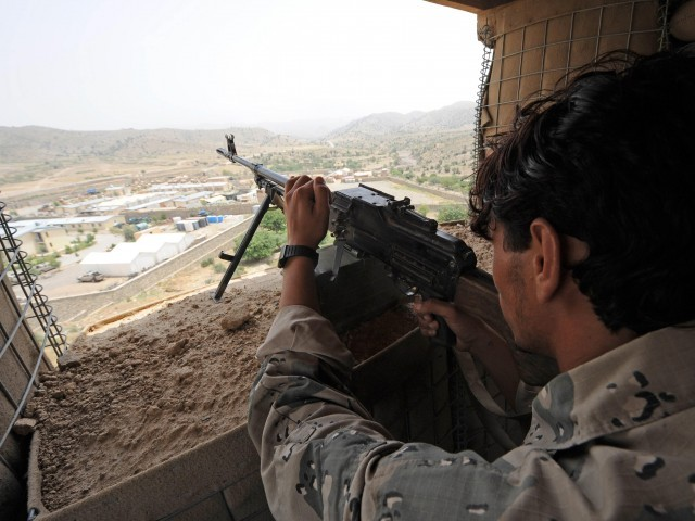 fghan Border police aims his AK-47 rifle towards the Gorbuz highway from a guarding tower as he monitors trucks loaded with goods coming from Pakistan's border to Khost province. PHOTO: AFP