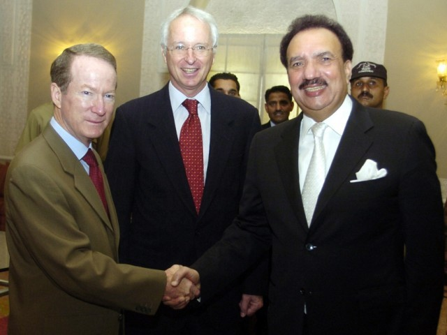 Assistant Secretary of State for International Narcotics and Law Enforcement Affairs William Brownfield (L) shakes hands with Pakistan's Interior Minister Rehman Malik (R) prior to US-Pakistan Strategic Dialogue on Law Reinforcement and Counter Terrorism meeting in Islamabad on July 5, 2011. PHOTO: AFP