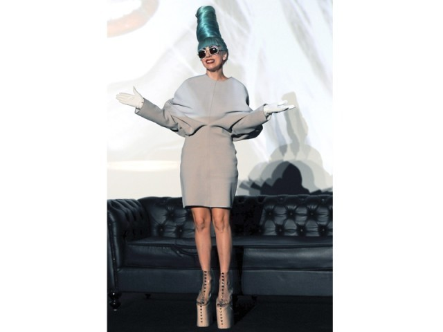 Lady Gaga poses at a promotional event in Singapore. PHOTO: AFP