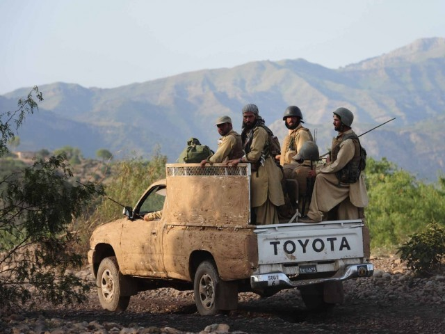 "Pakistani paramilitary forces patrol on July 9, 2011 during the ""Koh-e Safid"" (White Mountain) military operation against Taliban militants in central part of Kurram Agency, Pakistan's tribal belt bordering Afghanistan.  PHOTO: AFP"