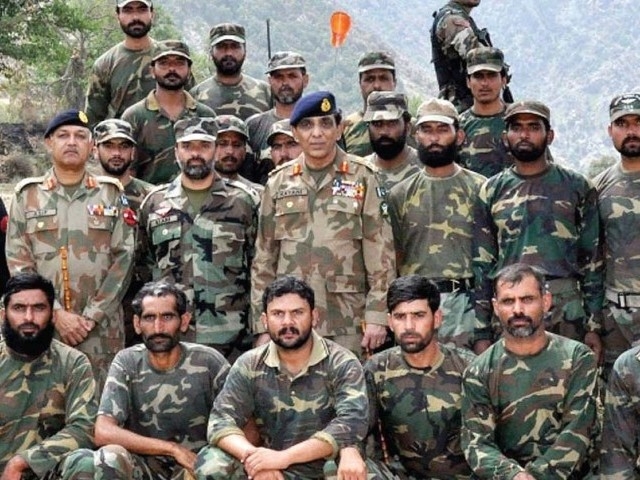 Chief of Army Staff, General Ashfaq Parvez Kayani with troops during his visit to Mohmand Agency. PHOTO: INP