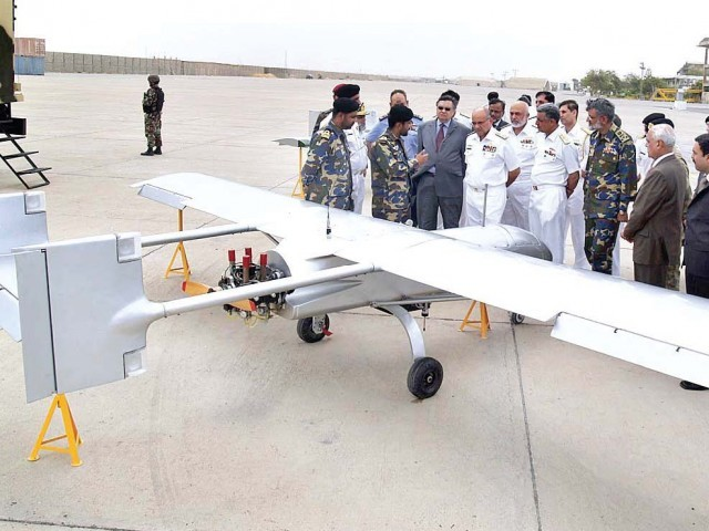 Navy chief Admiral Noman Bashir inspects one of the drones at PNS Mehran in Karachi. PHOTO: APP