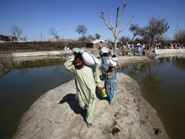 Residents are trying to drain water from their homes on a self help basis. PHOTO: REUTERS