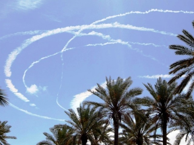NATO jetfighter condensation trails (contrails) are seen over the blue skies of the Libyan capital Tripoli on May 17, 2011, hours after a security services building and the headquarters of Libya's anti-corruption agency were damaged, apparently being hit in NATO air strikes. PHOTO: AFP/FILE