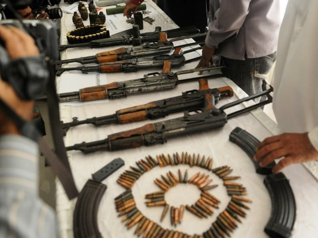 Cache of weapons recovered from terrorists included weapons, ammunition, suicide jackets. PHOTO: AFP/FILE