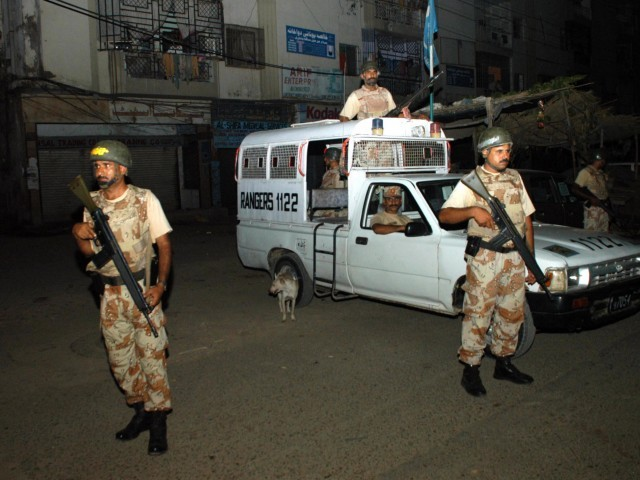 Rangers personnel stand alert near the troubled Old Sabzi Mandi in Gulshan-e-Iqbal. PHOTO IRFAN ALI/EXPRESS