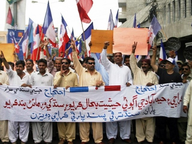 Sindhi nationalists from civil society and the lawyer community organised a protest outside Karachi Press Club on Tuesday against the LG system on August 9 2011. PHOTO: PPI\RIZWAN ALI