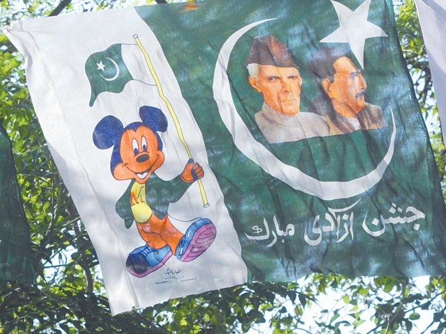 The founder and the scholar are joined by the world's most famous rodent. PHOTO: QAZI USMAN/EXPRESS