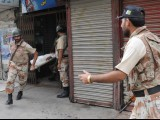 Rangers personnel evacuate an injured person in Saddar area of violence hit Karachi. PHOTO: RASHID AJMERI/EXPRESS