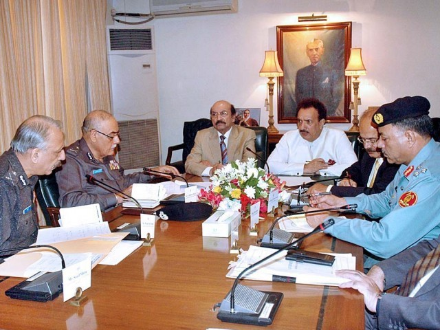 Sindh CM and Interior Minister Rehman Malik hold law and order meeting held at CM house in Karachi.  PHOTO: PPI