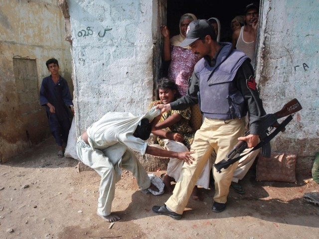 A policeman grabs a man as he protests while being detained during a the operation. PHOTO: REUTERS