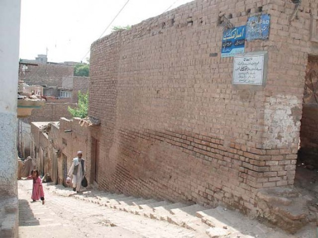 Shahji-ki-Dheri Gandharan Buddhist site presents a view of a squatter settlement nowadays. PHOTO: EXPRESS