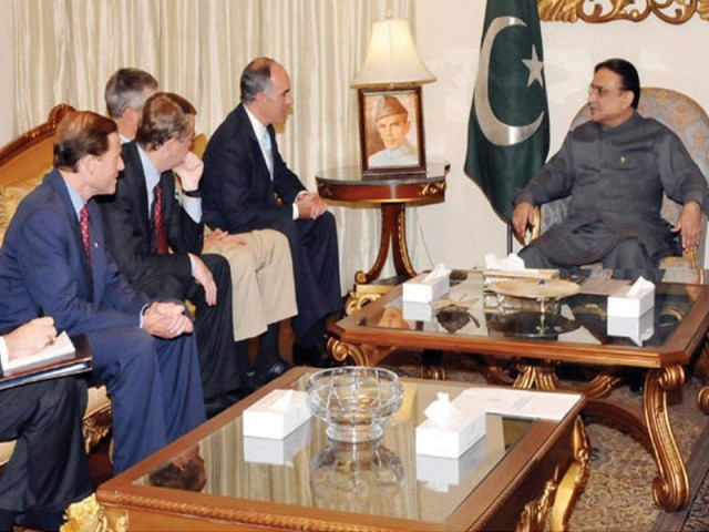 President Zardari meets US senators at the President House. PHOTO: AGENCIES