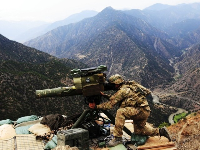 U.S. soldier Staff Sergeant Frankie Berdecia of Alpha Company 2nd battalion 27th infantry (the Wolfhounds), Task Force NO FEAR from Puerto Rico, operates a TOW missile system at Observation Post Mace in eastern Afghanistan's Kunar province near the border with Pakistan August 28, 2011. PHOTO: REUTERS