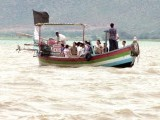 Tourists enjoy a ride on a boat, while others wait for loading. PHOTOS: MUHAMMAD SADAQAT