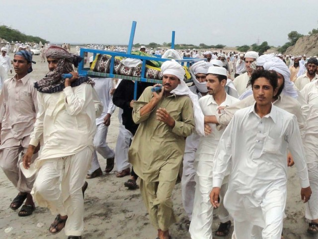 Relatives and local residents carry the body of a blast victim during a funeral ceremony after Thursday's attack in Lakki Marwat. PHOTO: AFP