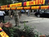 Indian security personnel stand guard outside the Delhi High Court at the site of a bomb blast in New Delhi on September 7, 2011. PHOTO: AFP
