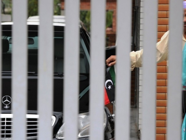 A car with the rebel flag at the main gate of the embassy in Islamabad on August 25, 2011. PHOTO: AFP