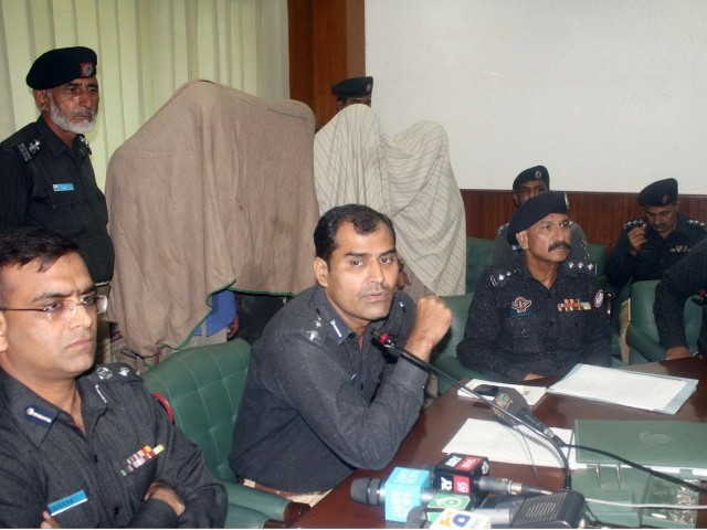 This August 23, 2011 photo shows Karachi police presenting suspected target killers. A target killer arrested in Madina town on Sunday has confessed to killing 2 MQM workers. PHOTO: FILE/PPI